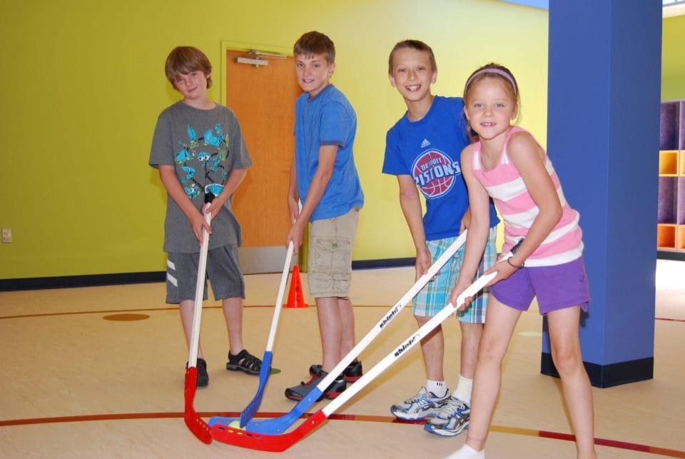 kids playing indoor hockey